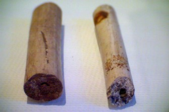 Fig 5. Left  A late 17th century clay pipe stems Fig 5. Right 18th century clay pipe stem